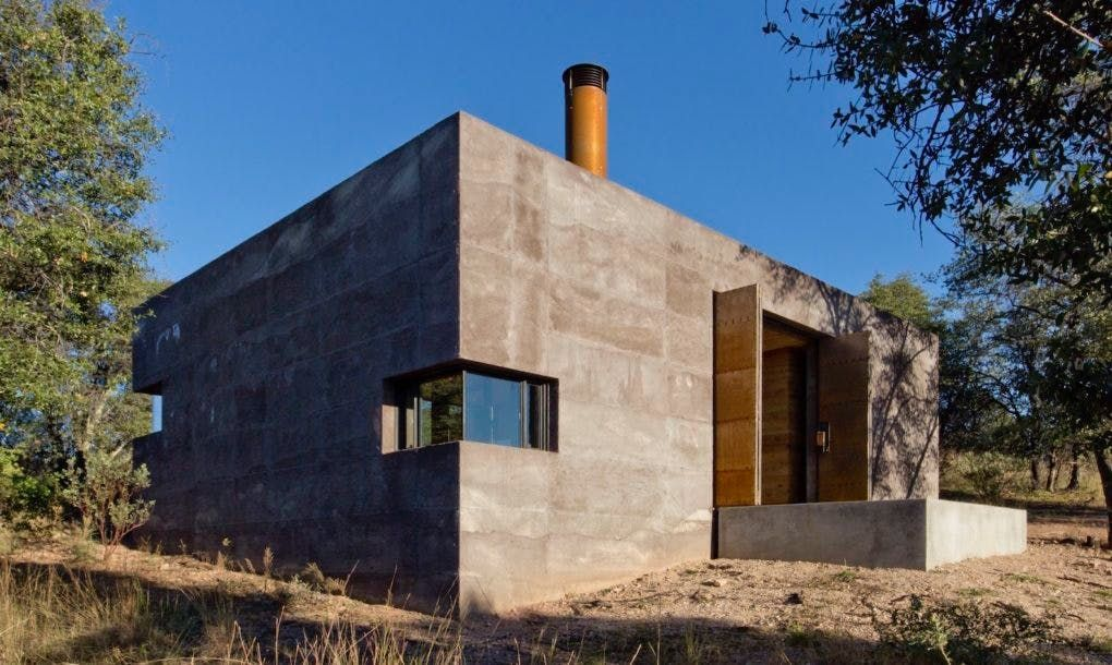 This Plain Off The Grid Bunker Has A Gorgeous Vacation Home Hiding Inside Concrete House Architecture Rammed Earth