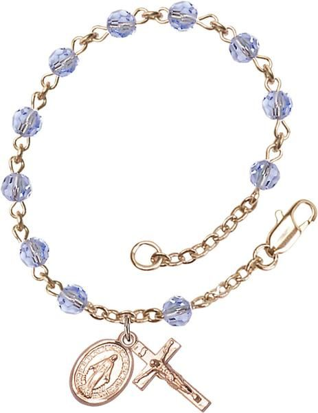 14kt Gold Filled Rosary Bracelet features 5mm Light Sapphire Swarovski beads. The Crucifix measures 5/8 x 1/4. Each Rosary Bracelet is presented in a deluxe vel