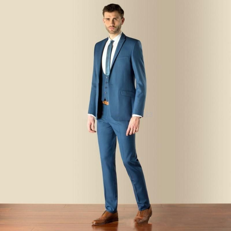 Want to feel casual at that next wedding? Consider lighter suit colors  paired with brown