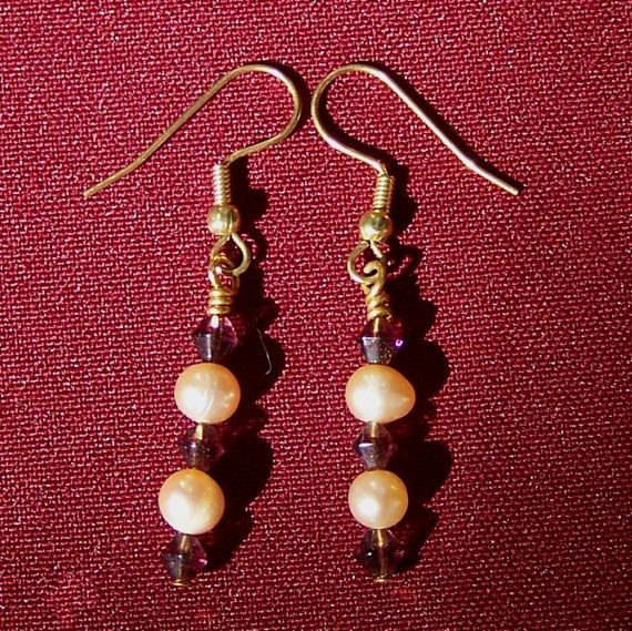 Exquisite pink freshwater pearls and burgundy glass bicones combined with gold earwires make these earrings into something really special.