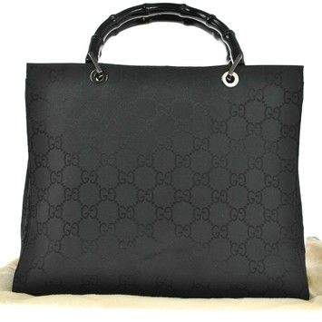 a2e5b742ac07 Gucci Gg Logos Bamboo Hand Canvas Vintage Italy Black Tote Bag. Get one of  the hottest styles of the season! The Gucci Gg Logos Bamboo Hand Canvas  Vintage ...