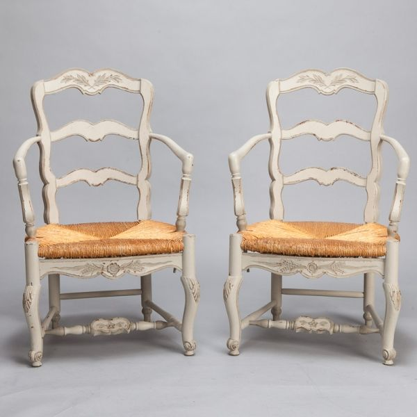 """Pair White Painted French Armchairs With Rush Seats  --  Pair of circa 1920s French armchairs have an antique white painted finish with leaf detail on top of backrest, cabriole front legs and woven rush seats.  -- Arm Height:  27""""  -- Seat Height:  18.25""""  -- Seat Depth:  20""""  --   Item:  5739  Retail Price:   $2695"""