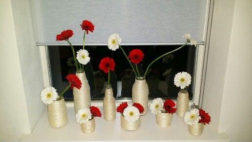 Potjes en flesjes omwikkeld met sisal