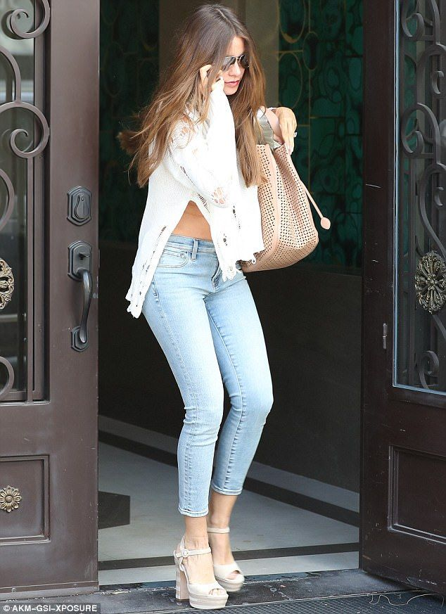 50ffde1d8e9326 Flash lady: Sofia Vergara showed off her taut tummy as she left a tailors  shop in Beverly .