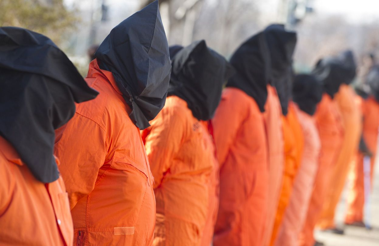 protestors wear orange prison jumpsuits and black hoods on 10 protestors wear orange prison jumpsuits and black hoods on their