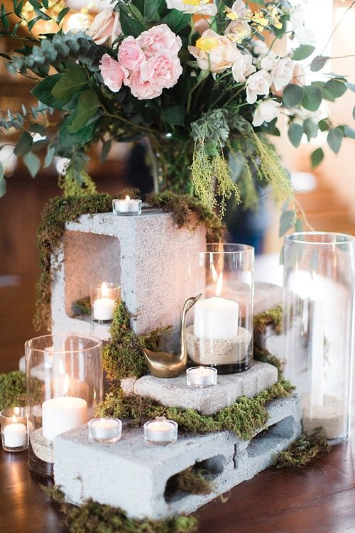 Cinder blocks can add a great industrial look to a centerpiece display. Florals soften the look, and candles make the space inviting. *Paisley & Jade: Vintage & Specialty Furniture & Prop Rentals for Events, Weddings, Tradeshows, Films, Theatres, & Photo Shoots*
