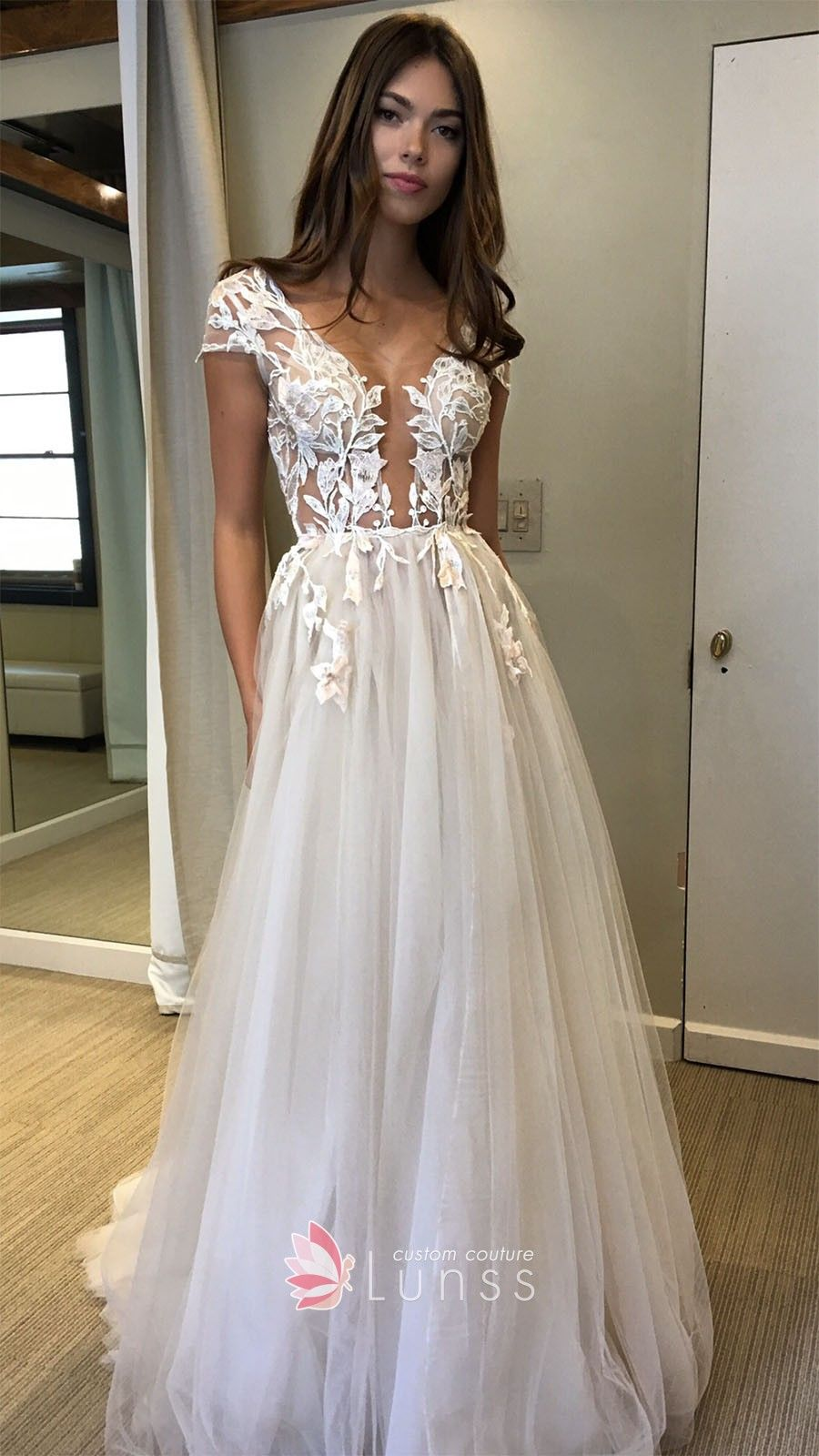 44646635a5 White lace appliqued cap sleeve ivory tulle evening prom gown. Plunging  neckline natural waist floor length tulle gown.