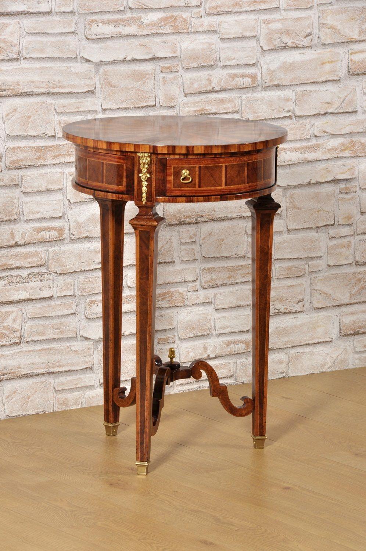 Mobili Con Cassetti Nascosti tavolino rotondo intarsiato con stelle in legni pregiati