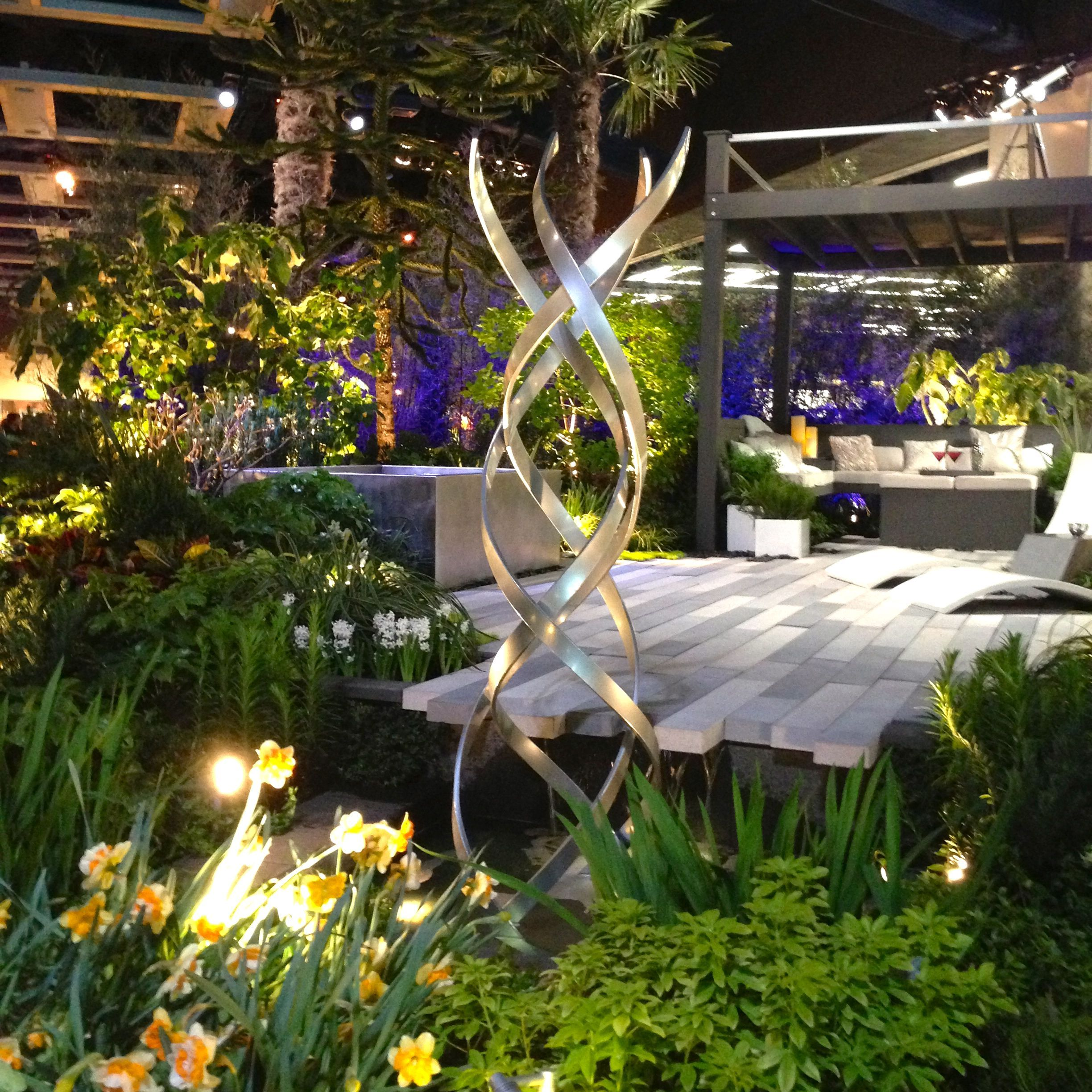 Modern Water Garden With Beautiful Lighting And Fresh Plants