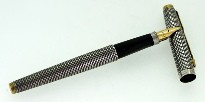 fe6e08e4ff44 Currently at the  Catawiki auctions  Vintage Black Parker Pen With 14K  Yellow Gold Nib With sterling silver cap an.