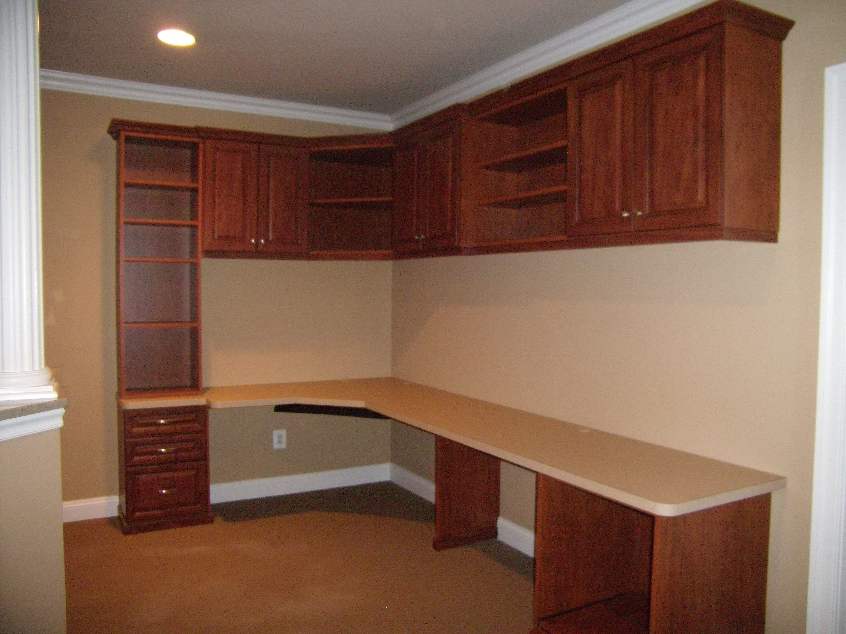 L Shaped Work Space With Overhead Shelves And Cabinets Design A