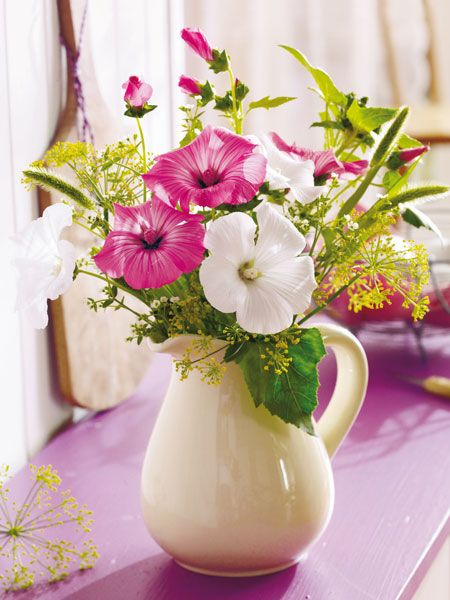 A Charming Casual Summer Arrangement Cut Hibiscus Flowers In A