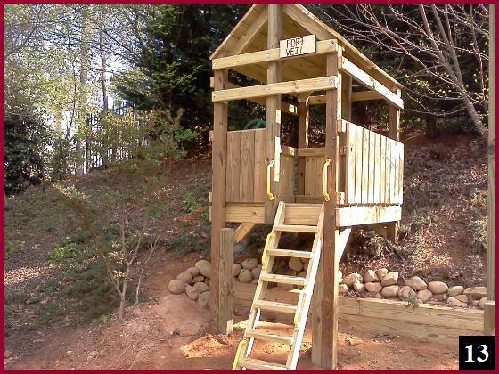 Fort On Hillside   Playset landscaping, Backyard playhouse ...