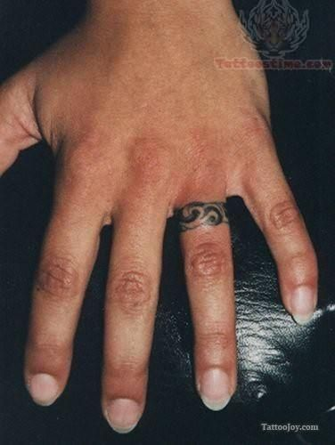 Ring Tattoo On Left Hand Finger With Images Wedding Finger Tattoos Tattoo Wedding Rings Ring Tattoo Designs