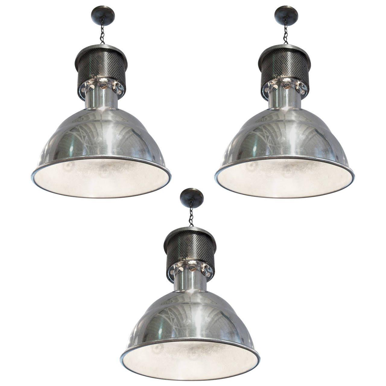 Set of three large industrial chrome metal light pendants