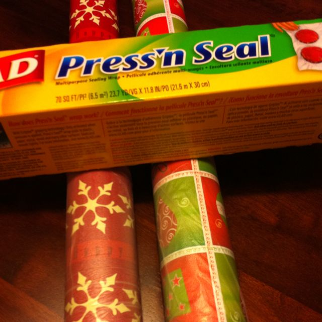 Wrap a piece of Glad Press'n Seal around your wrapping paper roll to keep it from unrolling. It comes off cleanly, is reusable, and doesn't damage the paper like tape or rubber bands.
