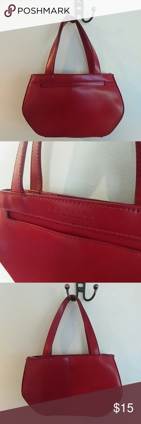 Reaction Kenneth Cole handbag Deep red leather-like handbag by Kenneth Cole. 10 inches wide, 7 inches tall. Front pocket plus one zip inner pocket and zip closure. Barely used, excellent condition. Kenneth Cole Reaction Bags Mini Bags