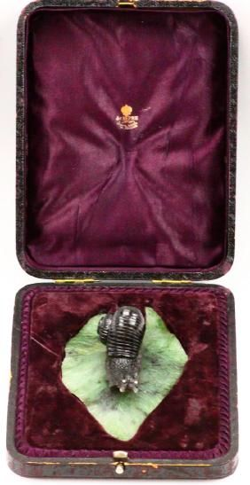 """Lot: K. Faberge Obsidian """"Snail"""" on Nephrite Leaf, Lot Number: 0002B, Starting Bid: $1,000, Auctioneer: GWS Auctions Inc., Auction: Russian Aristocratic Family Estate Auction, Date: July 29th, 2017 CDT"""