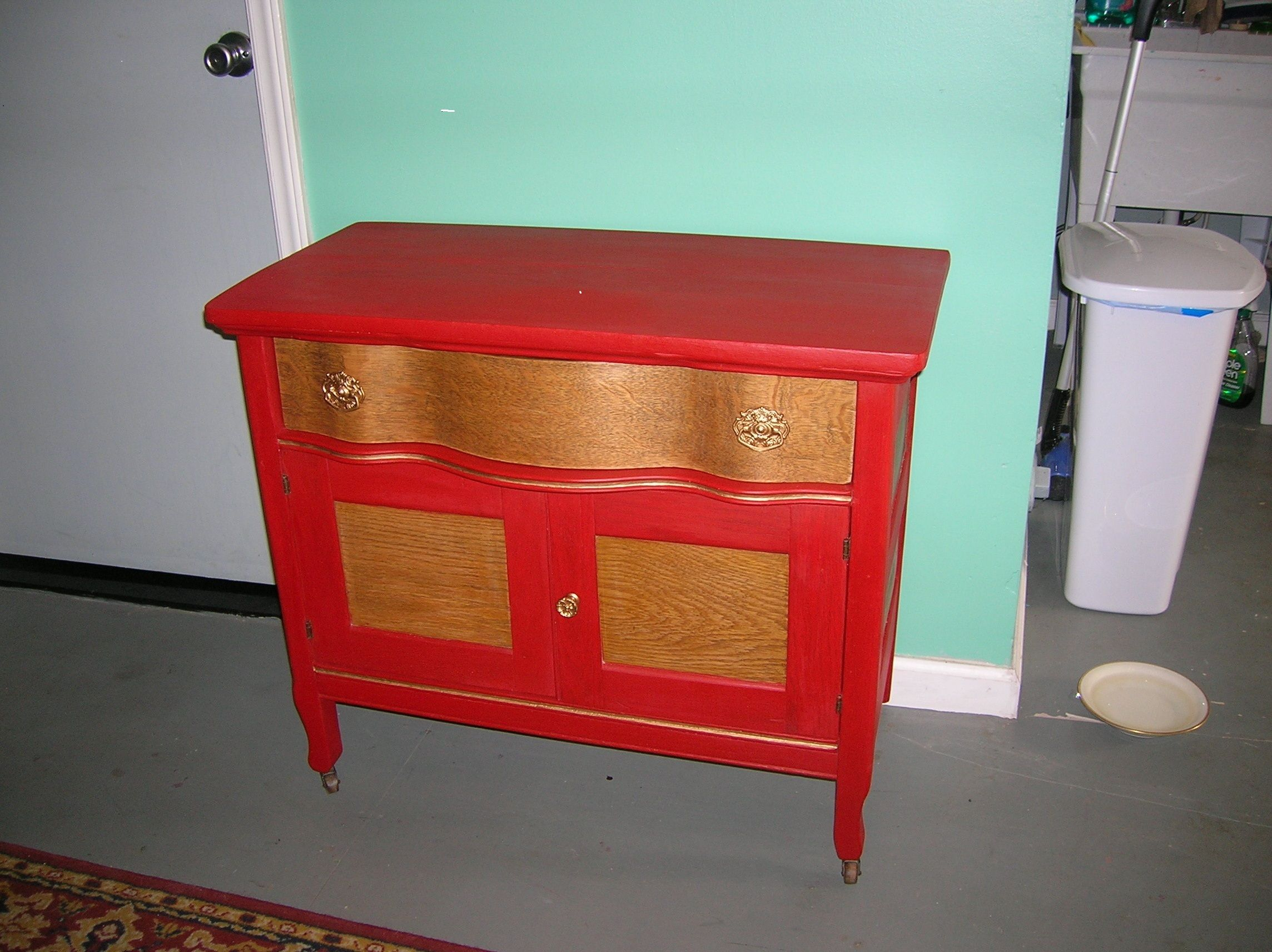This is a golden oak wash stand that has been given a