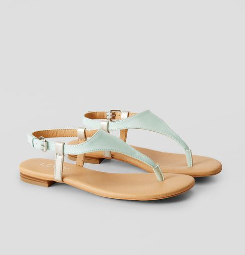 """Warm weather style should be easy and carefree, and these irresistibly sleek sandals are just the ticket. Adjustable buckle ankle strap. Padded footbed for comfort. 1/4"""" heel."""