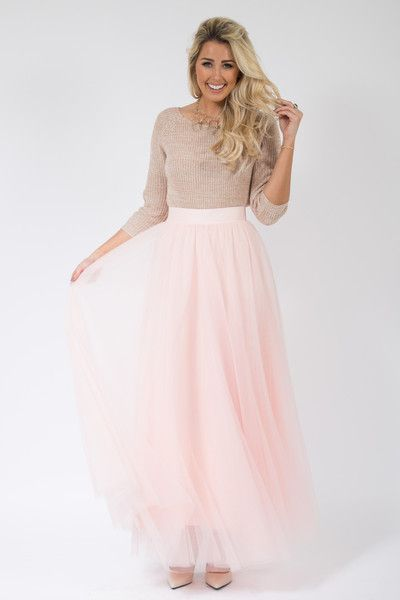 b6b3d0f4ba This ultra chic tulle skirt can be dressed up or down for any occasion with  a basic cotton tee or a beautiful lace blouse. Length approximately 42  inches.