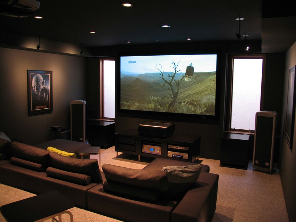 The Basement Is An Absolutely Perfect Spot For An Awesome Hangout And A Home Bar A Practical Home Home Theater Seating Home Theater Rooms Home Theater Design