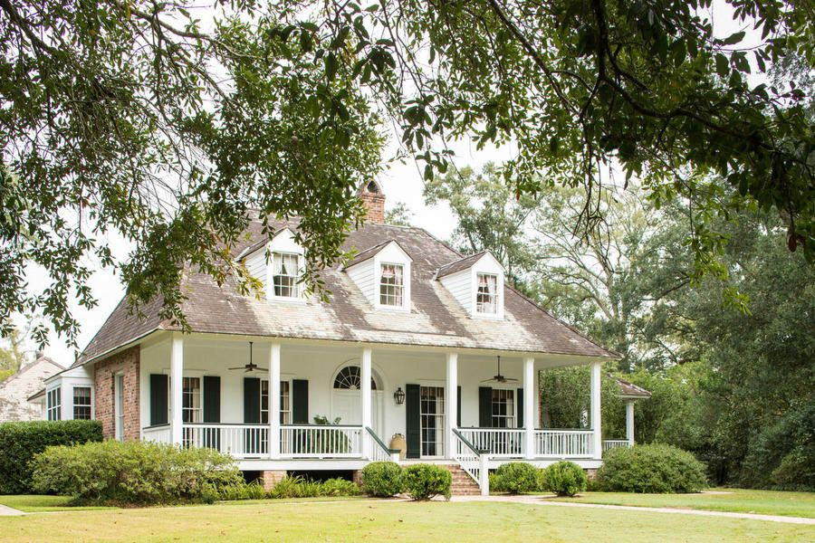 timeless white home best houses of 2016 southernliving classic scale and a reclaimed slate roof give this baton rouge home designed by a hays town in