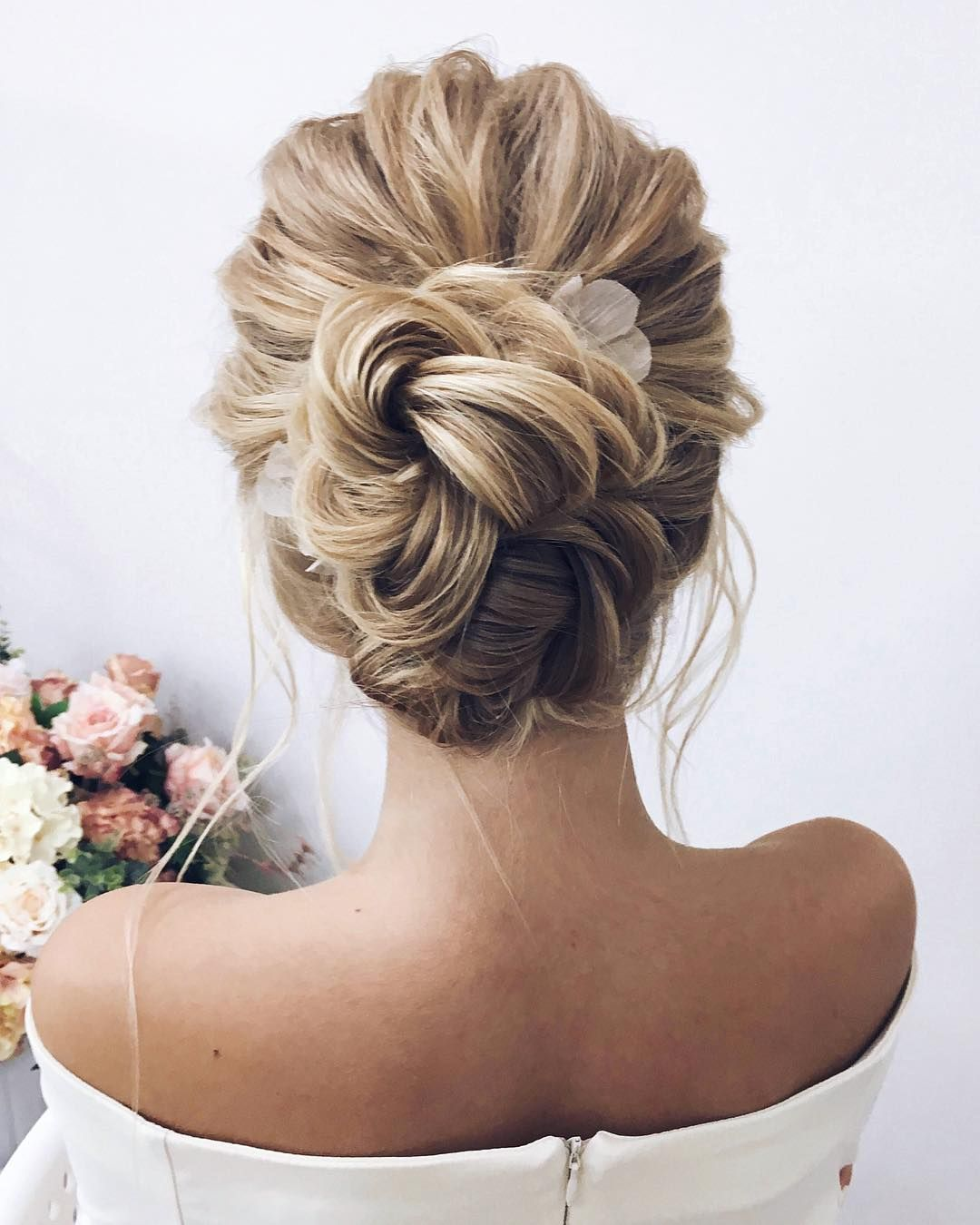 Unique updo hairstyle , high bun hairstyle ,prom