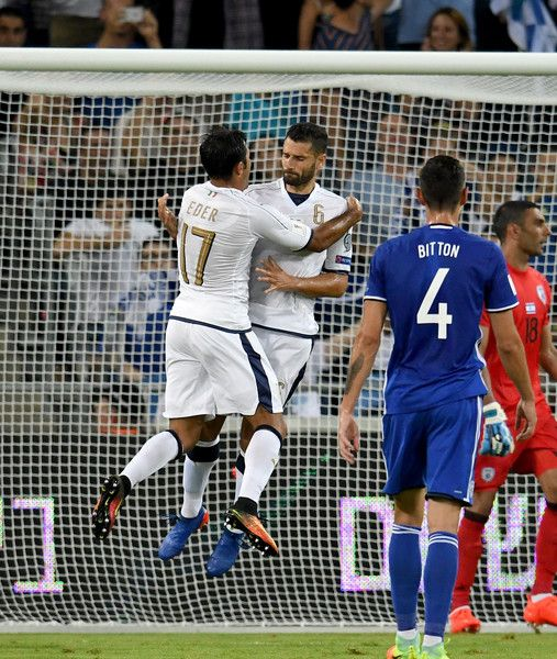 Antonio Candreva of Italy (R) celebrates after scoring the second goal during…