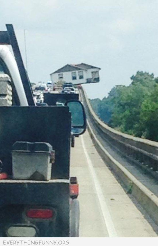 funny photos house looks like falling off truck and bridge