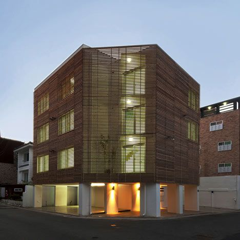 Wooden Louvres Mask The Facade Of This Apartment Block In