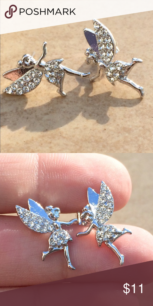 Silver Tone Crystal Tinkerbell Fairy Stud Earrings Silver tone fairy stud earrings are set with clear crystal accents with posts and friction backs.  Whether you are a Tinkerbell fan or a believer of fairies, these earrings are so fun.  Measure 3/4 inch L X 1/2 inch W. Jewelry Earrings