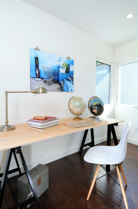 sawhorse + plywood desk with globes