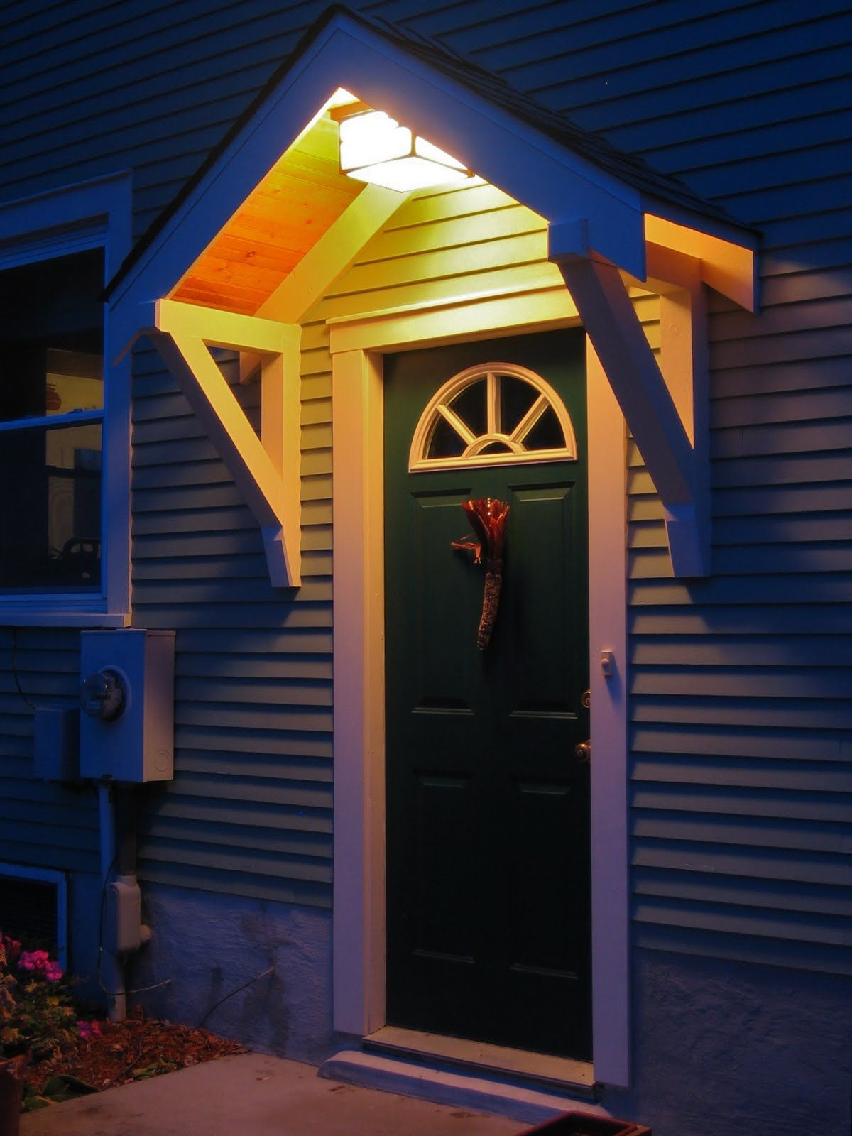Since we bought the house we always thought the side door entrance needed an overhang & roof over front door entrance | Bungalow Restoration: Side door ... Pezcame.Com