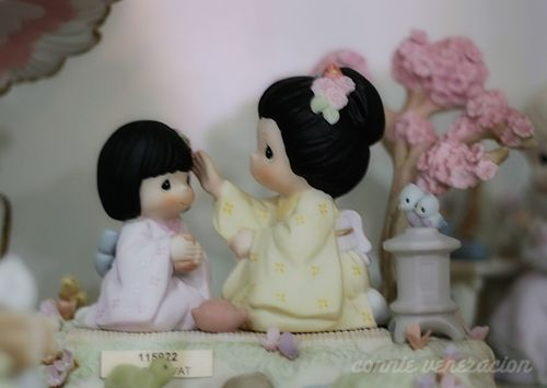 Asian precious moment figurine