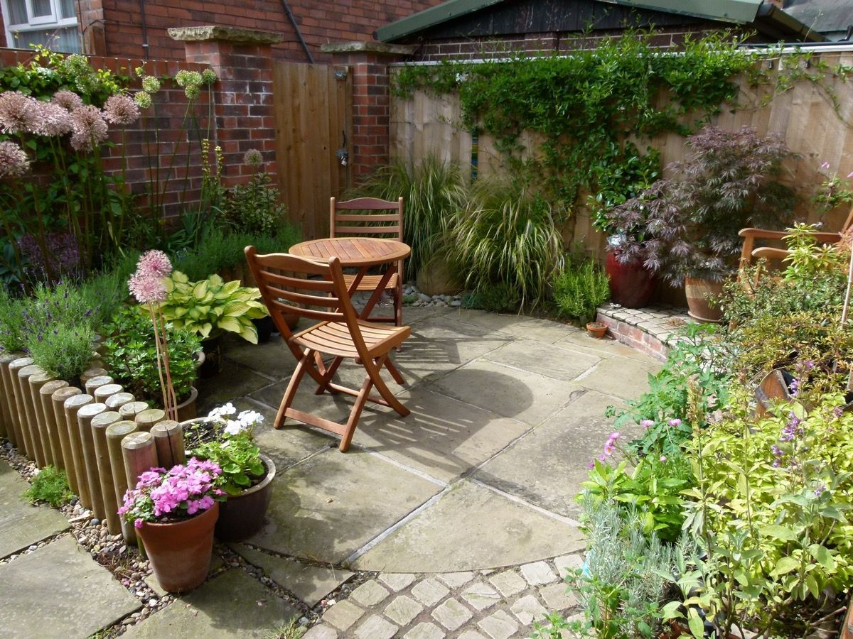 A round patio with plants around the edges - we could plant veg like courgettes and beans for height