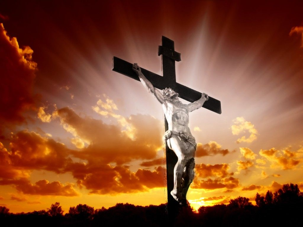 christian cross with jesus christ in beautiful sunrise christian