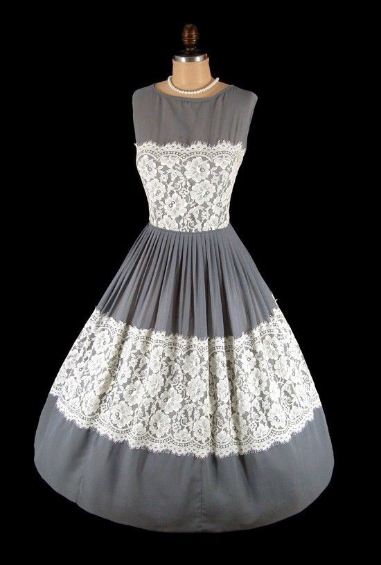 1950's gray chiffon and ivory lace cocktail party dress features a bombshell silhouette with a sheer illusion neckline, nipped waist and elegant full skirt