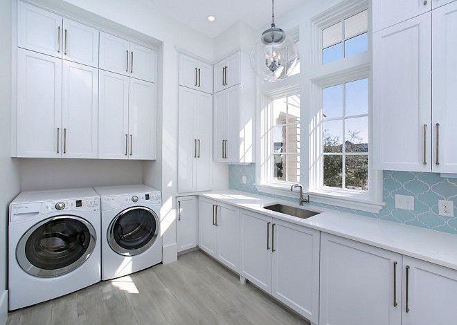 Blue Backsplash In A White Laundry Room By Corestruction