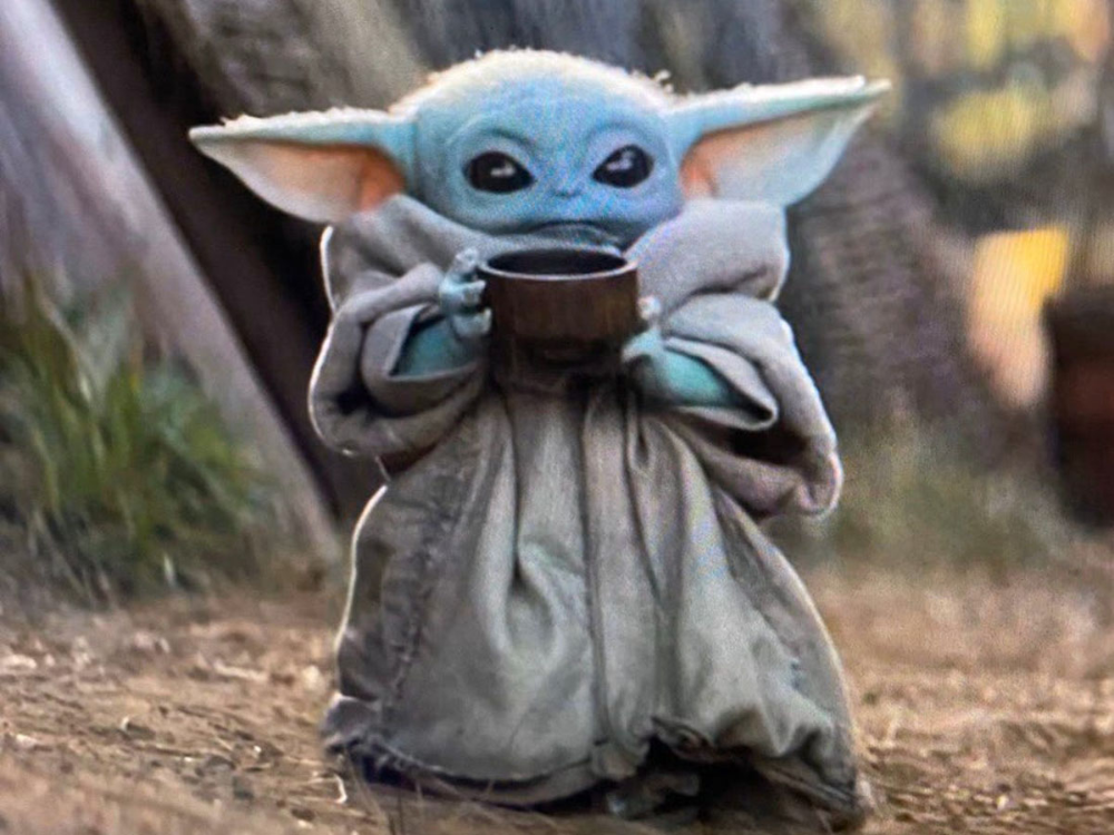 Baby Yoda With His Little Cup Is All Of Us The Mary Sue Yoda Images Yoda Meme Yoda Wallpaper
