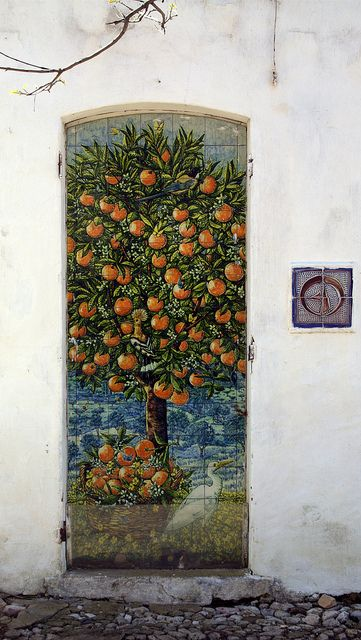This entry door with a painted peach tree is really a work of art!  If the art look is what you've got in mind for your #FrontDoor, we install doors with decorative glass in the Minneapolis MN area. http://www.replacementwindowsmpls.com/