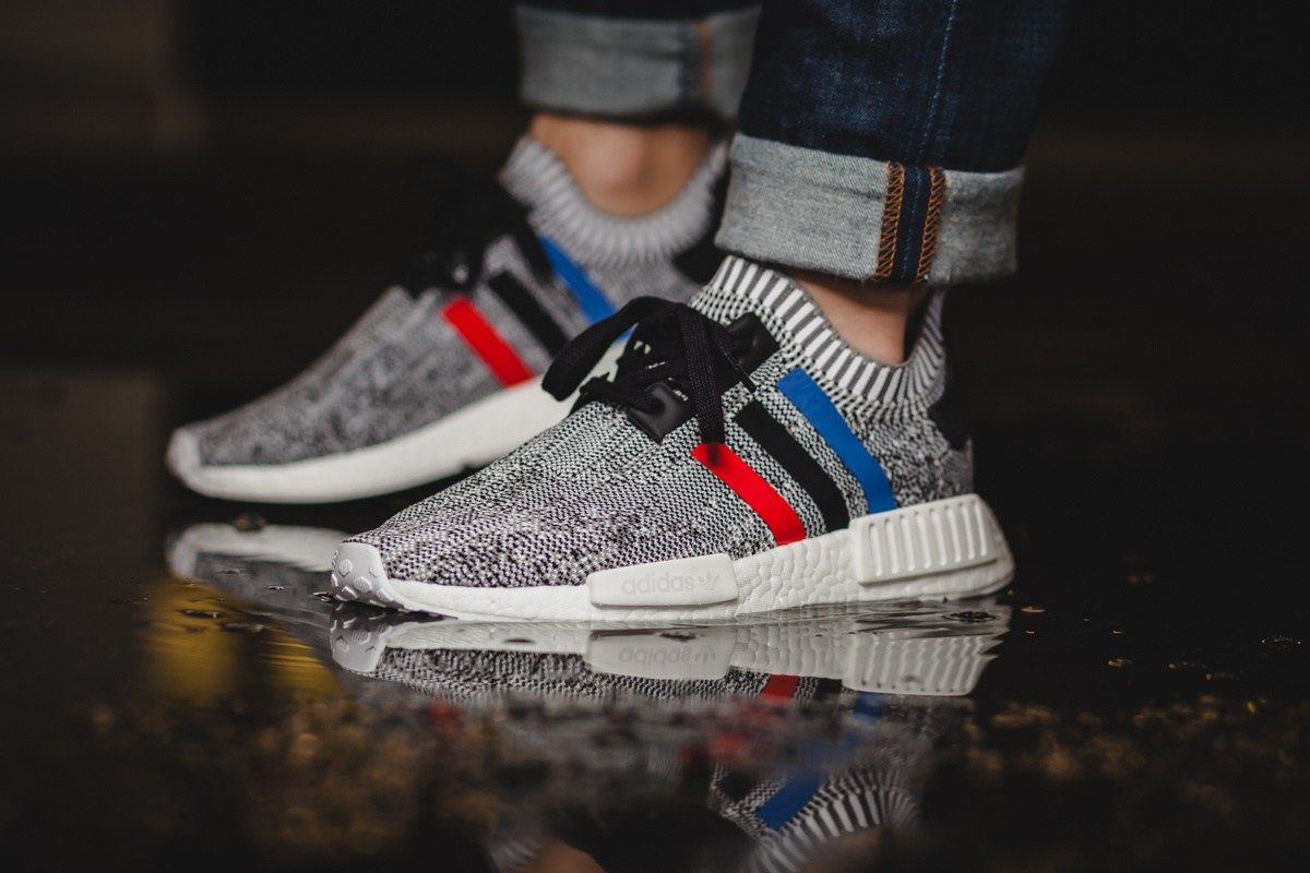 On Feet Photos of the adidas NMD R1 Primeknit 'Sun Glow' Sneakers