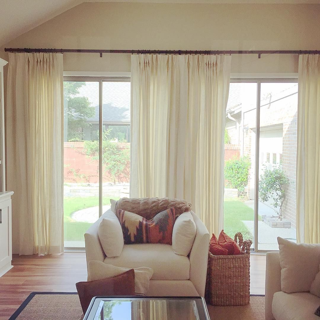 rustic living room sliding door | A rustic modern living room with window treatments on ...