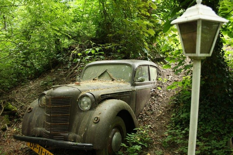 """""""A surreal showcase of dream cars nestled in the forest, unpolished, exposed to the elements, some even crashed into trees and others half buried in mud– this was his extravagant 50th birthday present to himself, a grand artistic display of rotting automobile history."""" --MessyNessy on Michael  Fröhlich's Auto Skulpturen Park."""
