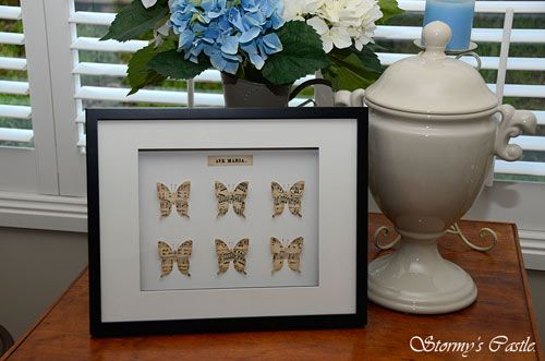 """Butterfly shadow box I made using a vintage sheet of """"Ave Maria"""" music."""