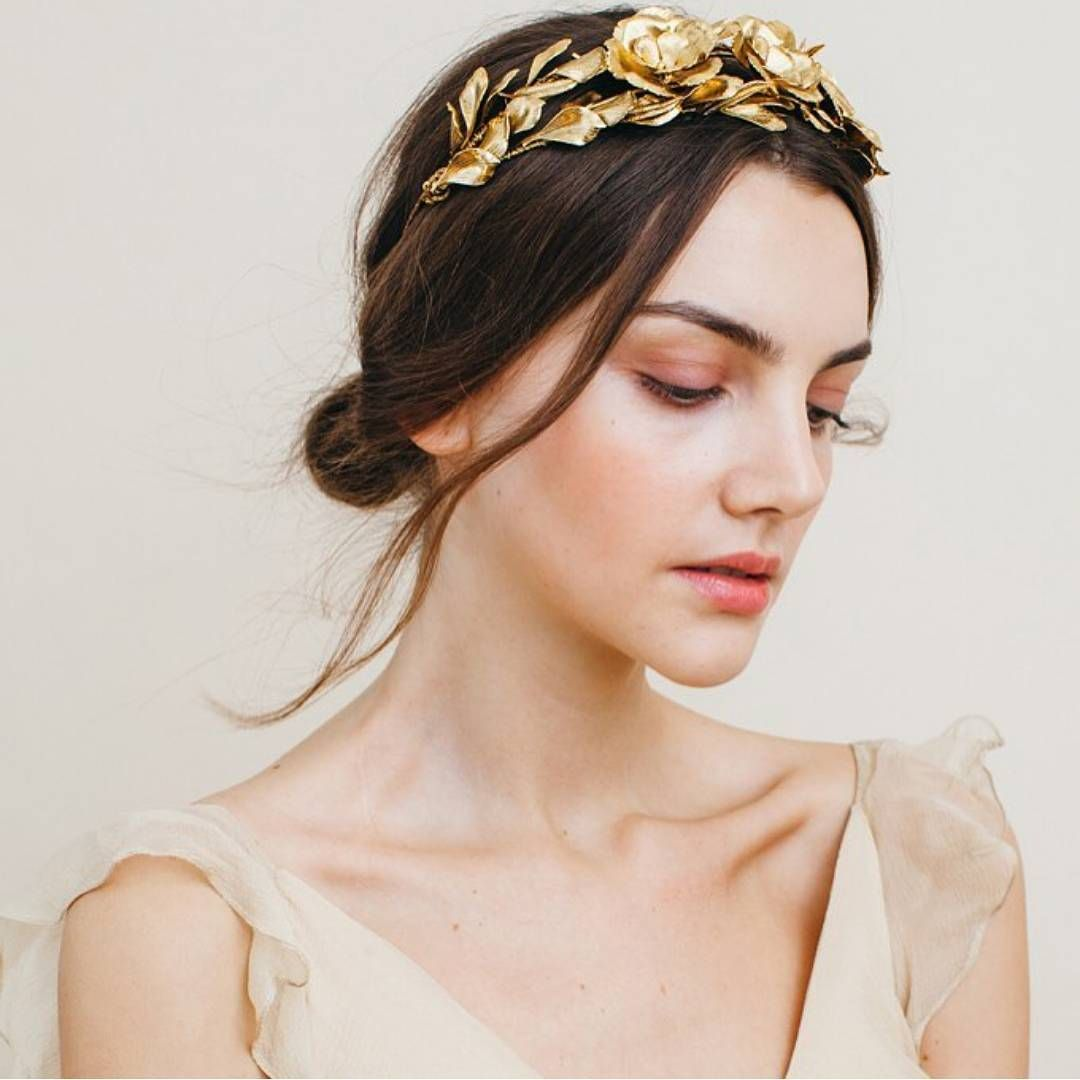 """A bridal headpiece has never been as beautiful as this one; suitable for your low 'do, the gold accessory adorned with floral and wreath detail really…"""