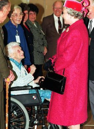 The Queen meets Joanna Rees, one of the oldest survivors of the Aberfan disaster during her visit to the Welsh village in 1997. 116 children died in the disaster in 1966, caused when colliery waste slid down a mountain and onto a primary school below.© Press Association