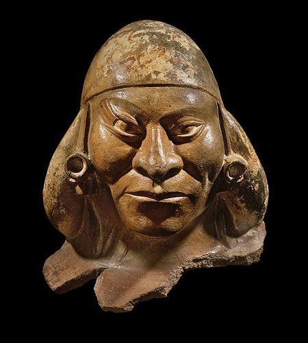 This portrait head gives clear proof of the Moche artists' great ability.  The realism and expression of this figure approaches some of the best ancient portrait sculptures in the world.  With his high cheekbones, strong nose, and pursed lips, the power of the individual is amply communicated.  The unusual oblique lines emanating from his outer right eyelid may be a congenital feature or scarification.    ca. 400-550 A.D.