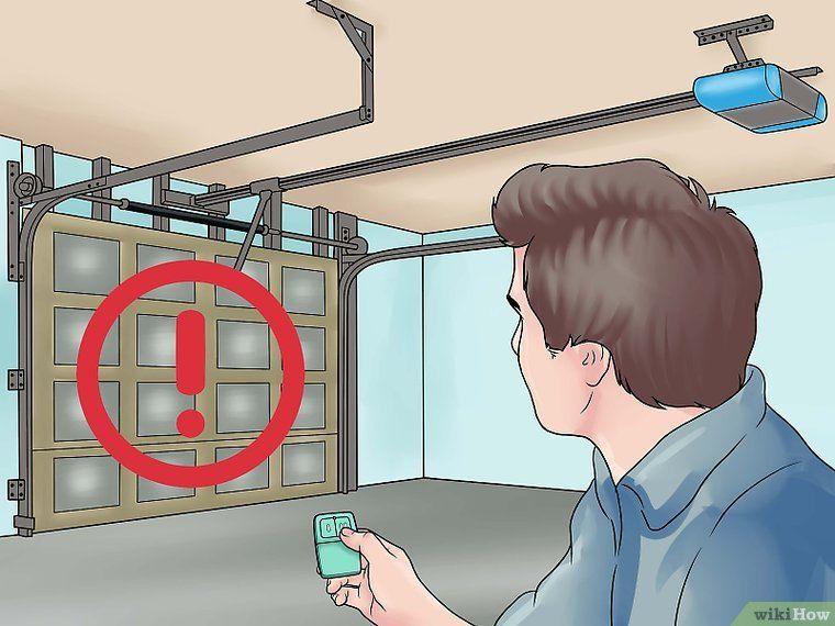 How To Adjust A Garage Door Spring In 2020 Garage Door Springs Garage Doors Garage Door Adjustment