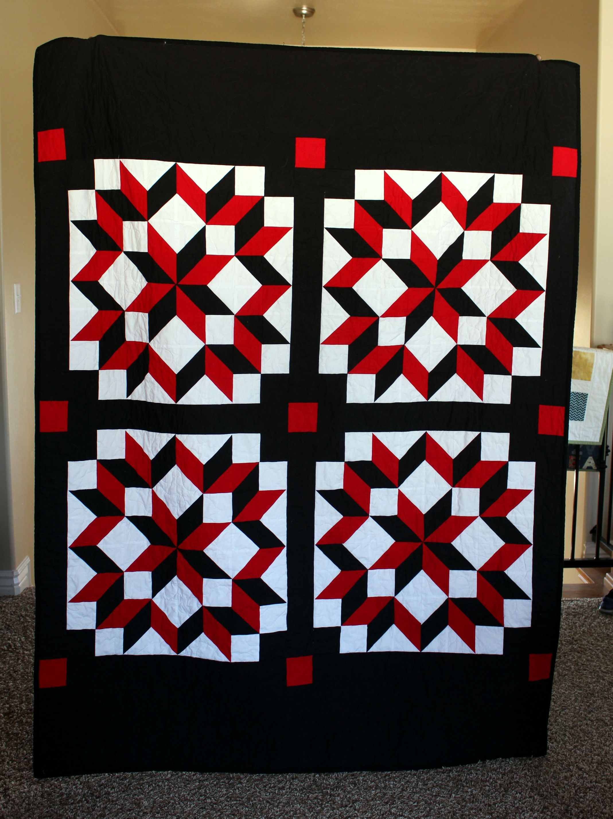 Solid White Black And Red Carpenter S Wheel Lap Quilt By